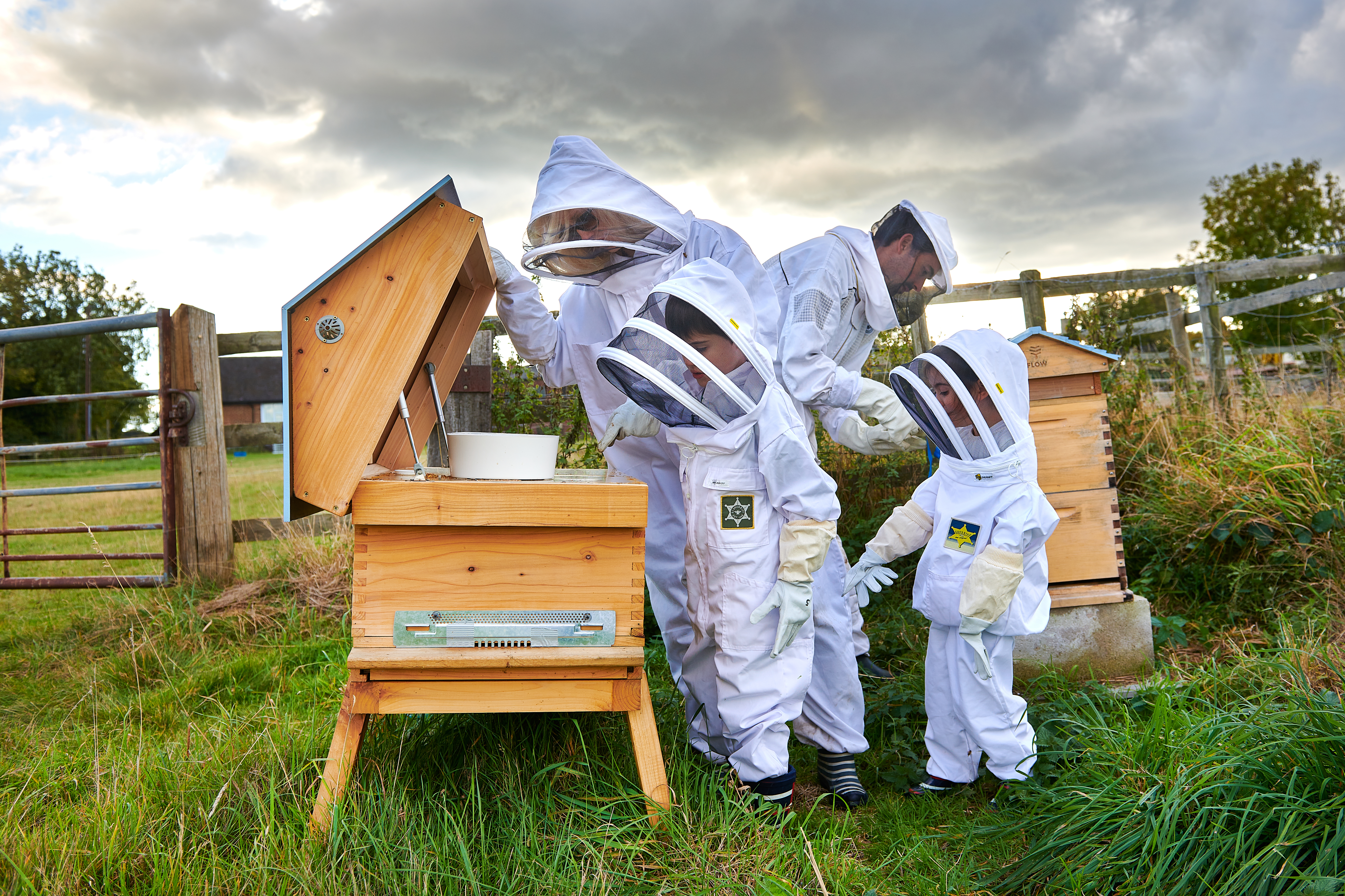 The Conti family check on one of their hives.