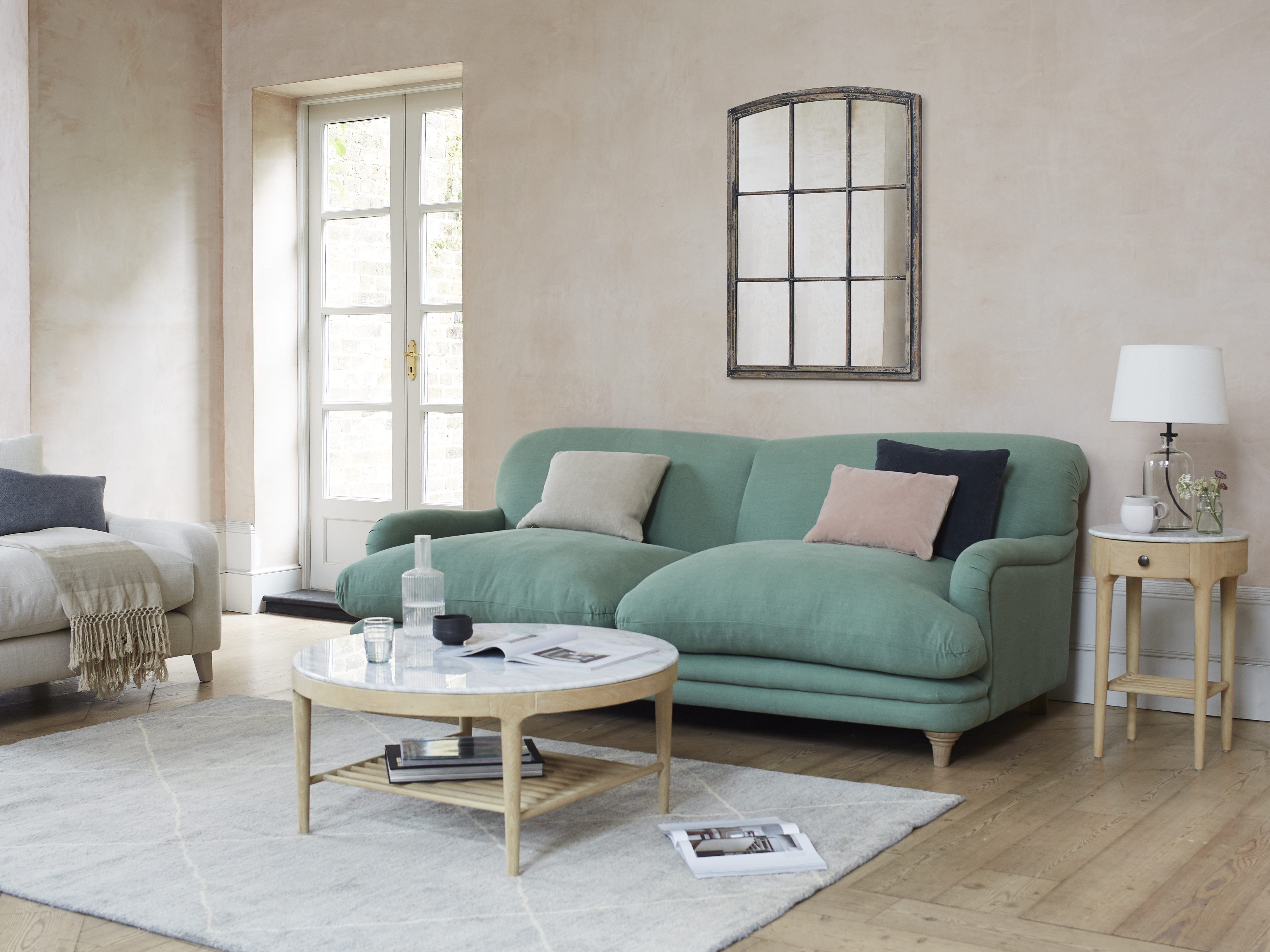 Pudding sofa in thyme green vintage linen, £1,395, www.loaf.com