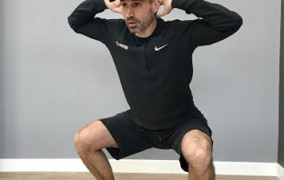 Raul Romero demonstrates a squat technique.