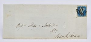 An original 1840 Twopenny Blue used to post a letter to Hawkshead. The stamp bears an 1844 frank, with markings for Keswick sorting office and a back-stamp for Ambleside on the wrapper.