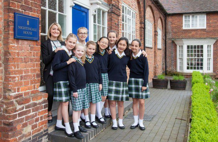 Housemistress Rachel Casey with boarders outside Nightingale Girls Boarding House.